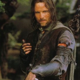 Aragorn (Viggo Mortensen) wearing Boromir's gauntlets in The Fellowship of the RIng (Lord of the Rings)