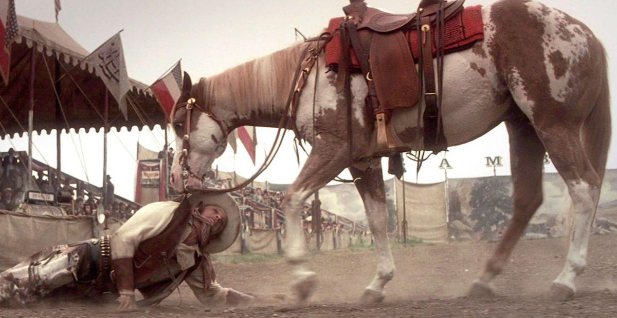 Hidalgo drags Frank (Viggo Mortensen) from the arena