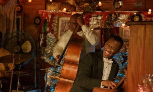 Mahershala Ali as Don Shirley playing piano in Green Book